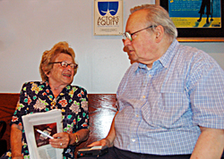 Dr. Ruth (l) answers a question from Larry Murray.