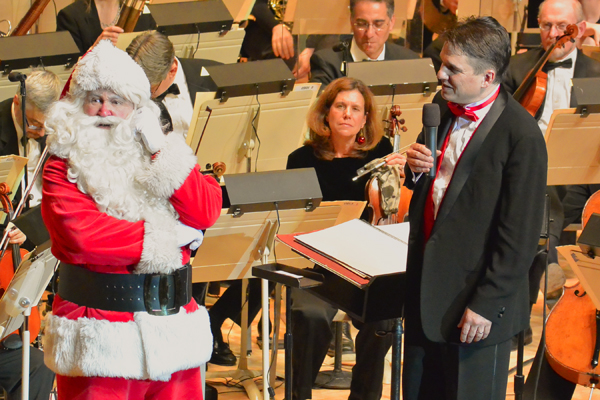 Santa visits the Boston Pops  and Keith Lockhart in this photo by Stu Rosner.