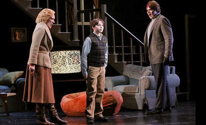 "New York City Opera production of ""The Turn of the Screw."" (l to r) Sara Jakubiak as the Governess, Benjamin P. Wenzelberg as Miles and Dominic Armstrong as Peter Quint. Photo by Carol Rosegg"