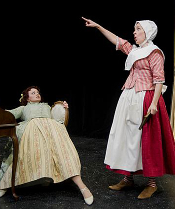 Dana Harrison (r) in the twin roles of Isabelle and Sabine is a knock-out as a blown away Lucrece (Emily Rose Ehlinger) demonstrates. Photo by Kevin Sprague..