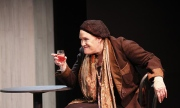 "Peggy Pharr Wilson as Gertrude Stein in ""There's No Here Here"". . Photo by Scott Barrow."