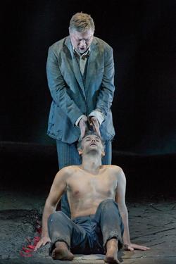 "René Pape (standing) as Gurnemanz and Jonas Kaufmann as the title character of Wagner's ""Parsifal."" Photo: Ken Howard/Metropolitan Opera"