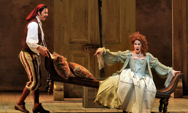 "Peter Mattei as Figaro and Joyce DiDonato as Rosina in Rossini's ""Il Barbiere di Siviglia."" Photo: Ken Howard/Metropolitan Opera"