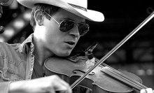 Stretch Secor is the fiddler for The Old Crow Medicine Show in a photo by Sarah Smith. He's an authentic native of the South.