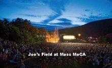 """The Solid Sound Festival takes place at several locations on the grounds of Mass MoCA. Here, at what has been dubbed """"Joe's Field"""" is the main stage. The museum director who helped get the festival going is Joe Thompson. Photo: Rick Levinson."""