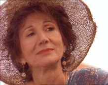 Olympia Dukakis as Anna Madrigal in Tales of the City.