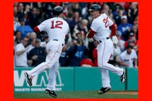 Things were looking good when Mike Napoli (12) celebrated with Daniel Nava after Nava's eighth-inning home run lifted the Red Sox ahead of the Royals in an emotional game on April 20.