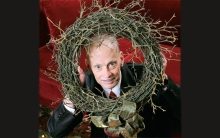 Waters endures the commercialization of Christmas as his wreath of thorns.