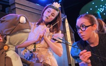 (Left to right): JEREMIAH THE BULLFROG (puppeted by Noah Simes, not pictured), Molly Kimmerling as THE GOOD FAIRY WATERLILY, Amy Meyer as ZIP THE DRAGONFLY Puppets featured in this photo are designed and constructed by Elizabeth Pearson and Jill Rogati.