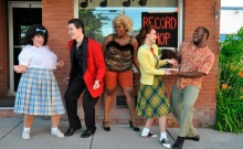 Practicing some moves at Motormouth Mabel's Record Shop are, from left, Conor Fallon as Link Larkin, Chantelle Cognevich as Tracy, Aneesa Folds as Motormouth, Emily Franklin as Penny Pingleton and Rasheem Ford as Seaweed J. Stubbs.  John Saunders and Colin Pritchard are featured as Edna and Wilbur Turnblad, Tracy's parents.