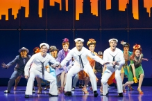 """(l to r) Clyde Alves, front row from left,  Tony Yazbeck and Jay Armstrong Johnson appear during a performance of """"On the Town,"""" in New York."""