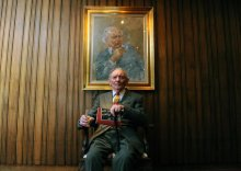 Brian Friel's with his portrait which hangs in the Abbey Theatre in Dublin. Photo by Aidan Crawley