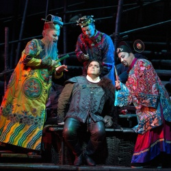 Ping, Pang and Pong try to get the stranger to tell them his name in Puccini's Turandot.