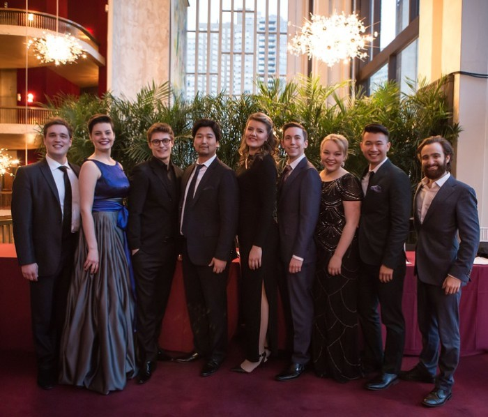 Sean Michael Plumb, Emily D'Angelo, Jakub Józef Orliński, Sol Jin, Yelena Dyachek, Jonas Hacker, Lauren Feider, Brian Vu, and Theo Hoffman pose together following the announcement of the Finalists. Photo by Rebecca Fay/Metropolitan Opera.