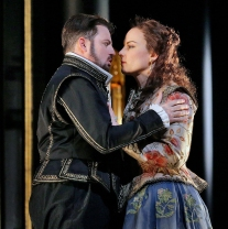 Matthew Polenzani in the title role and Elīna Garanča as Sara in Donizetti's Roberto Devereux. Photo by Ken Howard Metropolitan Opera.