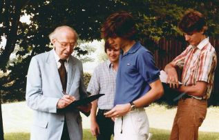 American composer Aaron Copland checks over a student's notations.