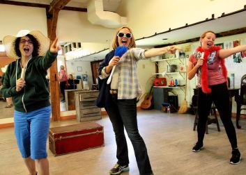 (l to r) Joanne Lessner (Rosie), Susan Haefner (Donna), and Brandy Zarle (Tanya) rehearse for Weston's upcoming production of Mamma Mia!