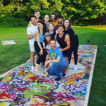 "Compton and cast creating the backdrop for ""Godspell 2012."""