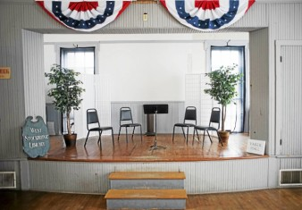 The stage in the 1854 Town Hall in West Stockbridge. Before the advent of electrical stage lighting the windows at the back of the stage illuminated the performers.